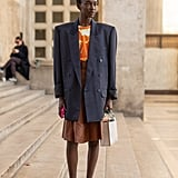 Style a bold-shouldered blazer with a knee-length skirt and kitten heels for a retro look.