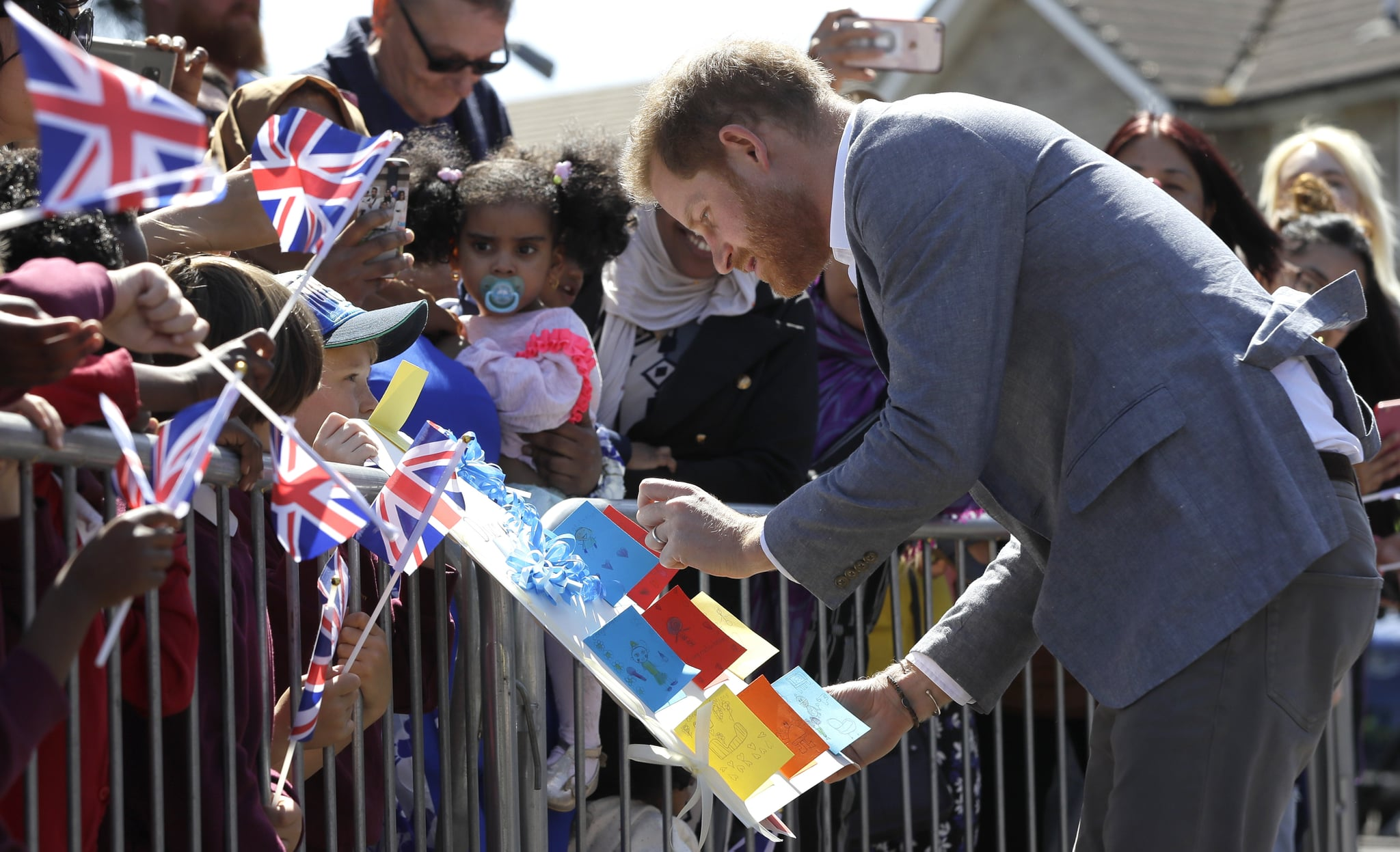 OXFORD, ENGLAND - MAY 14: Prince Harry, Duke of Sussex meets members of the public as he arrives for a visit to Barton Neighbourhood Centre on May 14, 2019 in Oxford, England. The centre is a hub for local residents which houses a doctor's surgery, food bank, cafe and youth club. (Photo by Kirsty Wigglesworth - WPA Pool/Getty Images)