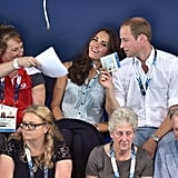 On Monday, William playfully used Kate's badge as a fan.