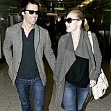 Ned Rocknroll and Kate Winslet wore matching outfits at Heathrow in January 2012.