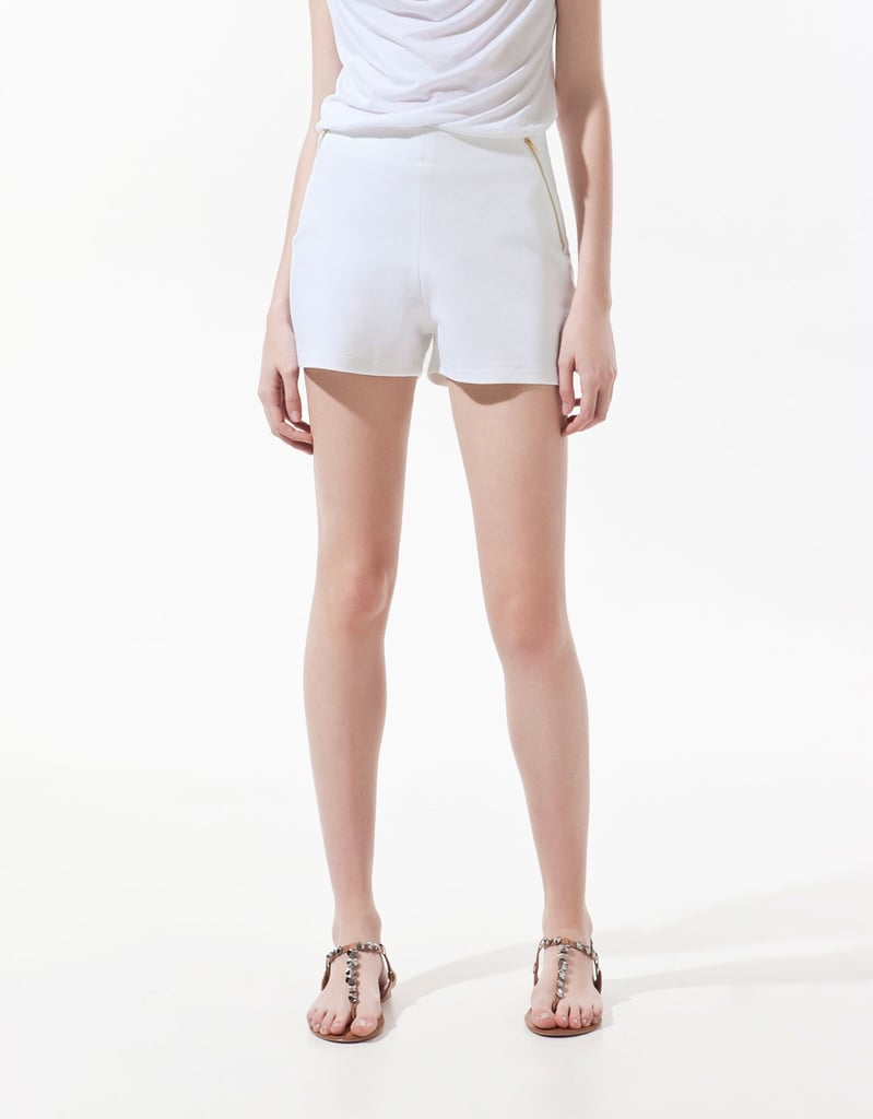 This sleek pair boasts gold hardware, making them easy to dress up with a blouse and metallic sandals.  Zara Shorts With Zips ($26)