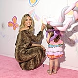 Heidi Klum colored on the backdrop of the pink carpet.