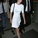 Emma Watson revealed her figure in a formfitting white short-sleeved ALC dress as she touched down in Nice. We love that she contrasted the crisp hue with touches of black via Ray-Bans and ankle boots by Tabitha Simmons.