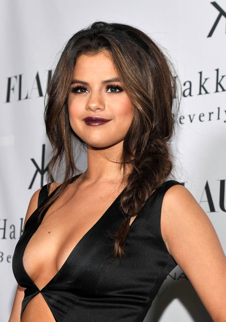 Selena Gomez sported dark lipstick with her vampy look at the LA event.