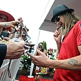 Kid Rock signed autographs on his way into the 2009 event.