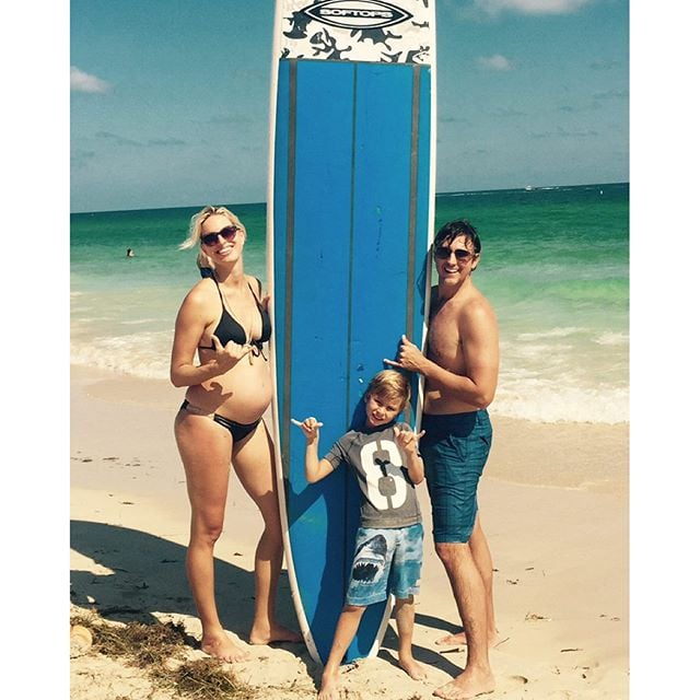 Karolina Kurkova shared a fun family surfing photo that showed off her pregnant belly.