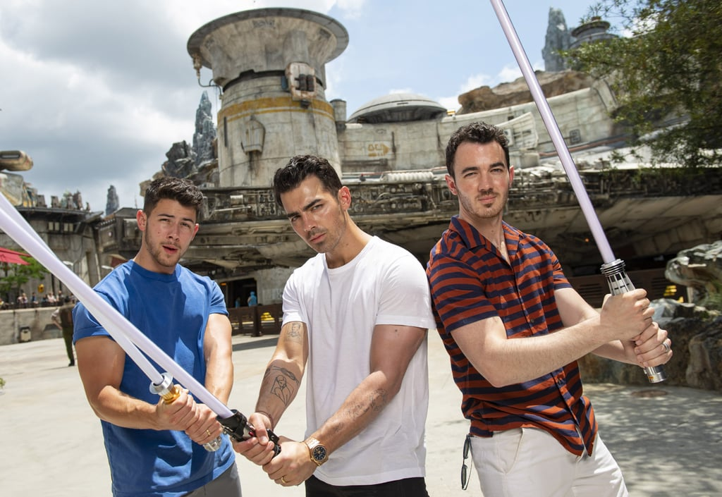 "The Jonas Brothers took over Disney World on Thursday. After an incredible opening night for their Happiness Begins tour in Miami on Wednesday, Kevin, Joe, and Nick jetted off to Orlando for a magical day at the happiest place on Earth. The brothers and former Disney Channel alums were joined by their entire family as they visited the parks.  While Kevin and Danielle took their daughters, Alena and Valentina, to see Cinderella, Joe documented his wife Sophie Turner's very first trip to Disney! In addition to visiting Magic Kingdom, the brothers also got a sneak peek at the upcoming Star Wars Land, which doesn't open to the public until Aug. 29. ""Return of the Jonai,"" Joe hilariously captioned a photo of him and his brothers holding lightsabers. See more of their latest appearance ahead.       Related:                                                                                                           These Pictures From the Jonas Brothers' Opening Night on Tour Will Bring You Pure Happiness"