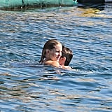 Kate Hudson and fiancé Matthew Bellamy swimming together.