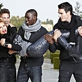 Lisa jumped into the male models' arms after Jay Manuel suggested they carry her.  Photo courtesy of The CW