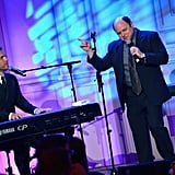 Jason Alexander belted out a tune with musician Gary Barlow.