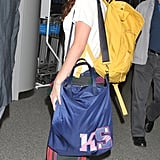 Kristen Stewart wore a backwards hat and yellow backpack at the Tokyo airport.