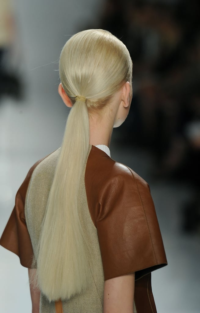 Using modernist architect Richard Neutra's clean, simple lines as a reference, Orlando Pita created a sleek, flat-ironed ponytail. To prevent flyaways, he worked Phyto Daily Intense Hydrating Cream into ends.