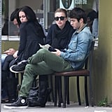 Emily VanCamp and Joshua Bowman sat outside of a restaurant.