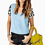 Once I spotted this mixed-print Nasty Gal top ($52), I knew it had to be mine. The chambray-leopard fusion is business in the front and party in the back, making it an ideal choice for a variety of events. Ace the music festival style scene by pairing it with mustard denim and statement-making shades. — MV