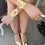 Vintage gold cuffs on both wrists were blindingly beautiful in the desert sun. And more is more when paired with matching ankle-strap flat-forms and statement-making gold rings.