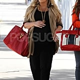 Jessica Simpson felt her baby bump while out shopping with a friend in LA.