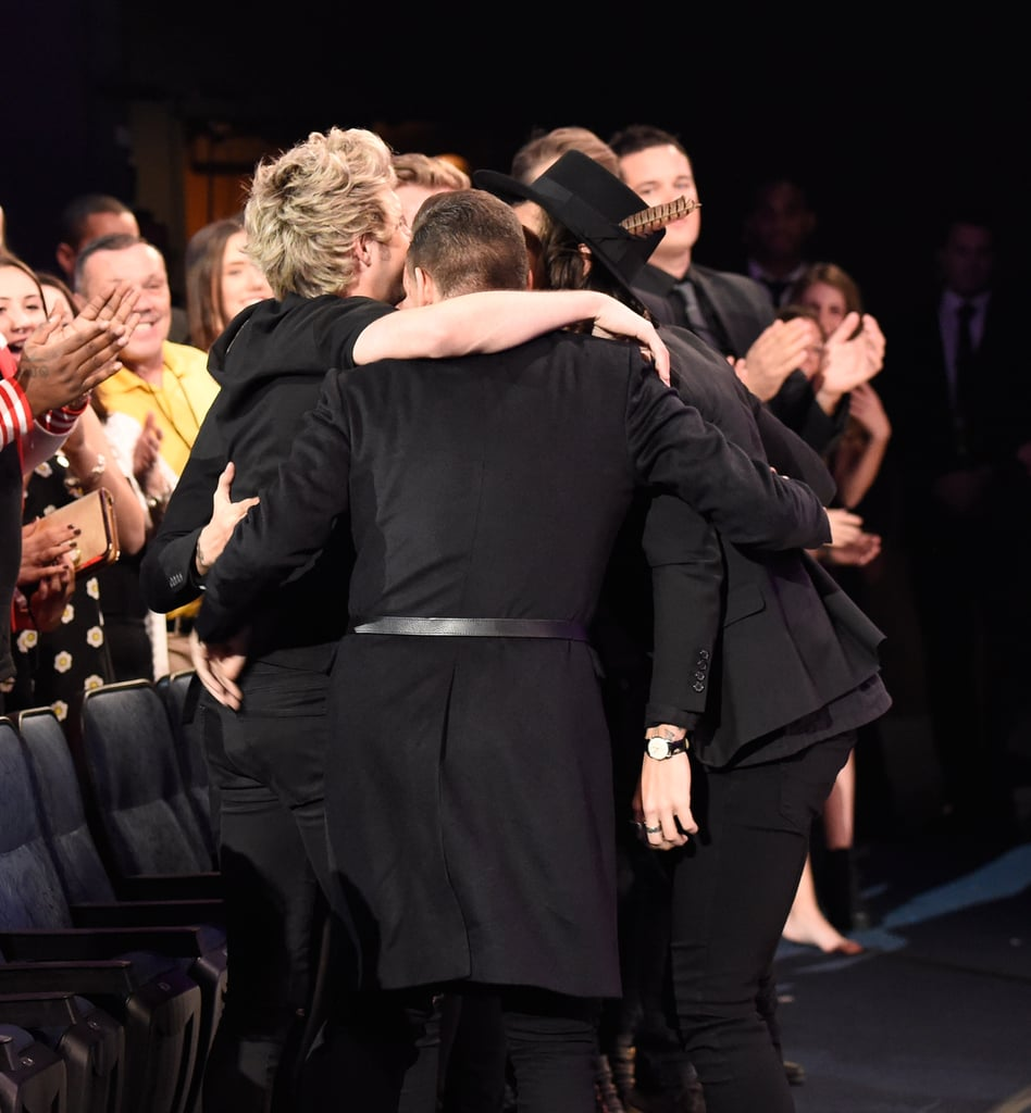 One Direction Celebrating Their Win at the American Music Awards in 2014