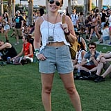 Grace Hitchcock, Senior Audience Development Associate at Popsugar, wore a white ruffled cami tank, high-waisted shorts, leather ankle boots, and a chunky pendant necklace.