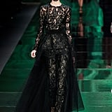 There's always one celebrity that takes a risk and goes with something unconventional on the Oscars red carpet, and for that lucky lady, we suggest this incredible black lace peplum jumpsuit from Monique Lhuillier's Fall 2013 runway.