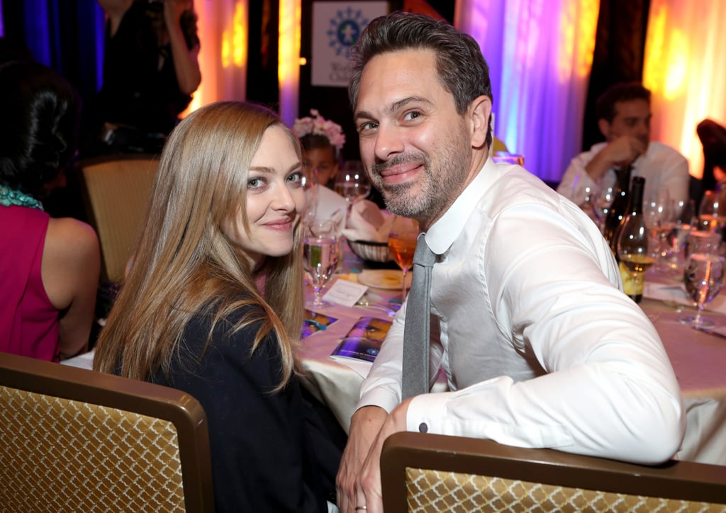 Amanda Seyfried and Thomas Sadoski have been busy lately. After tying the knot in a secret ceremony in mid-March, the newlyweds welcomed their first child, a baby girl, a few weeks later. The two took a break from diaper duty on Wednesday night to make their first red carpet appearance since their daughter arrived, and it was for an incredible cause. They happily posed hand in hand for photographers at the 2017 World of Children Hero Awards in Beverly Hills, CA, and also hopped in an adorable group photo with model Lily Aldridge and some of the event's pint-sized attendees. Amanda first met the actor in 2015 while working on the off-Broadway show The Way We Get By, and relationship rumors started swirling in March 2016 when they were spotted kissing during a lunch date.      Related:                                                                                                           Amanda Seyfried Cradles Her Baby Bump at a Movie Premiere With Fiancé Thomas Sadoski