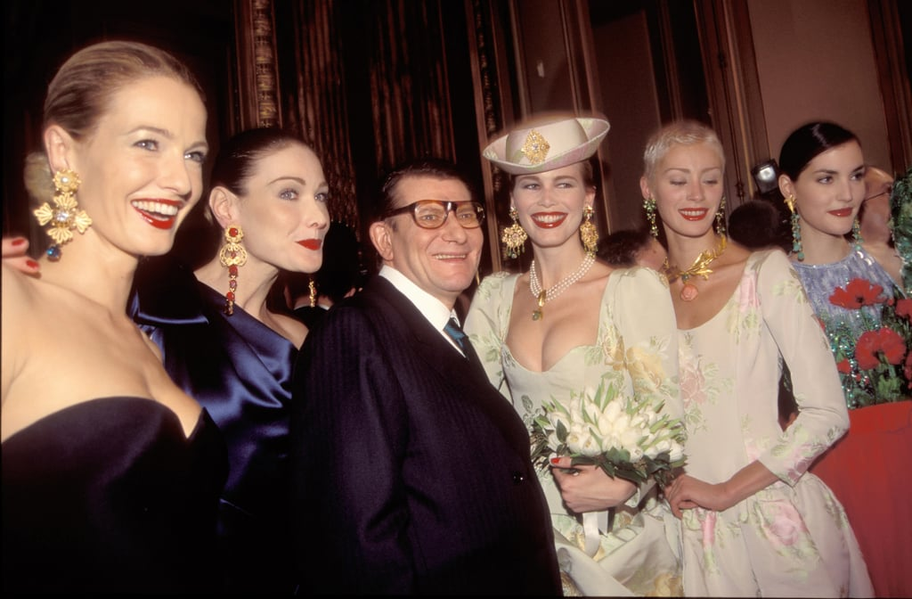 I spy a wedding-dress-clad Claudia Schiffer and a glamorous Carla Bruni with YSL after his Spring/Summer '97 couture presentation.