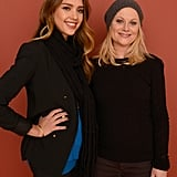 Amy Poehler and Jessica Alba smiled for a portrait.