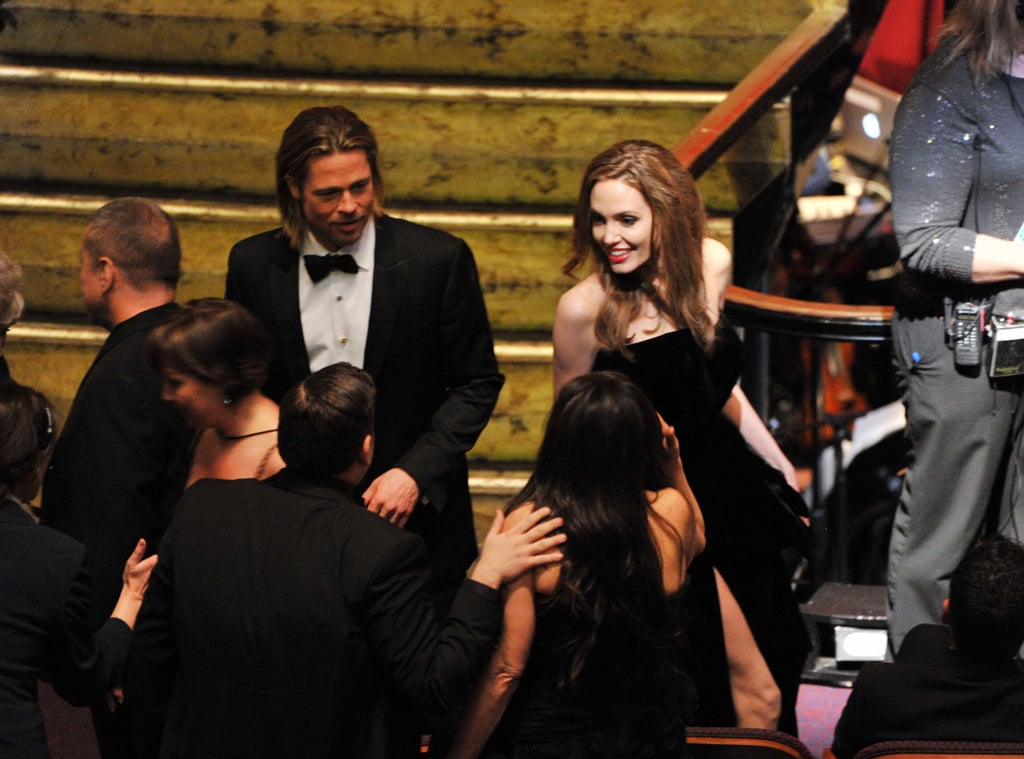 Angie flashes a huge smile to Brad's Moneyball costar Jonah Hill.
