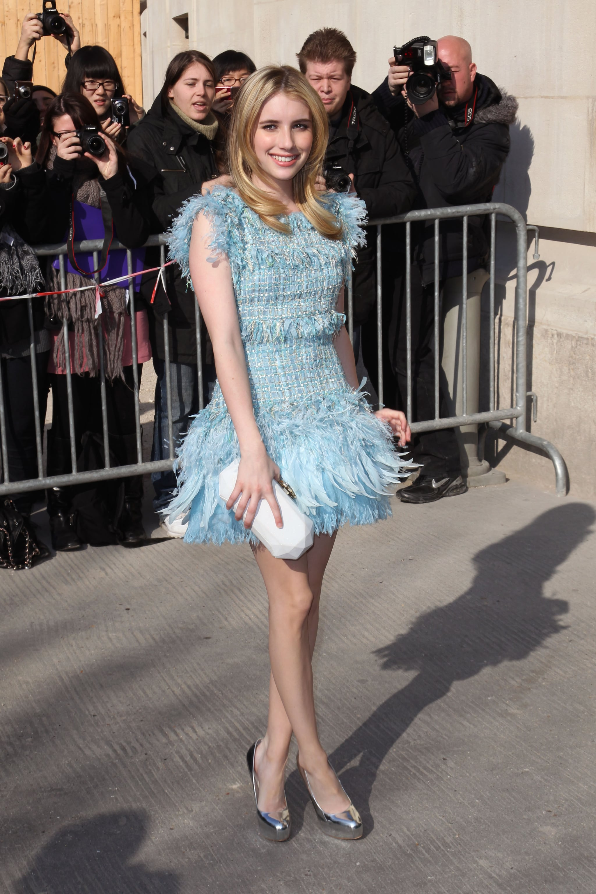 Emma got flirty in a fringed Chanel dress for Paris Fashion Week in 2011.