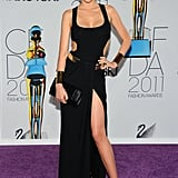 At the 2011 CFDA Fashion Awards, Miranda displayed her show-stopping curves in a cutout bodysuit, sarong skirt — complete with a thigh-high slit — and chunky gold-trim sandals, all by Michael Kors.
