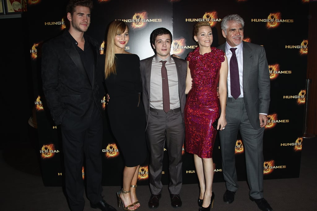 """The stars of The Hunger Games took their press tour to Paris today. Jennifer Lawrence, Josh Hutcherson, Elizabeth Banks, and Liam Hemsworth posed together during a photocall after popping up in London for a red carpet premiere yesterday. In the UK, Jennifer wore a gold Ralph Lauren gown, much like the Prabal Gurung look she chose at Monday night's world premiere in LA. This evening, though, she chose a simple black Tom Ford dress with an open back. Elizabeth Banks brought a pop of color in a berry-hued embellished outfit while Josh and Liam looked dapper in suits.  Jennifer recently addressed rumors of a feud between the Hunger Games and Twilight stars, saying that she actually contacted Kristen Stewart. Jennifer told Access Hollywood, """"I just shot her an email, and was like, 'Hey, can't wait to see more as this feud unfolds!'"""" She """"wrote me back, and she was like, 'It's fine.' So, she understood."""""""