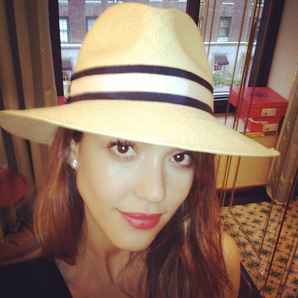 Jessica Alba tried on a hat at Tory Burch.  Source: Instagram user therealjessicaalba