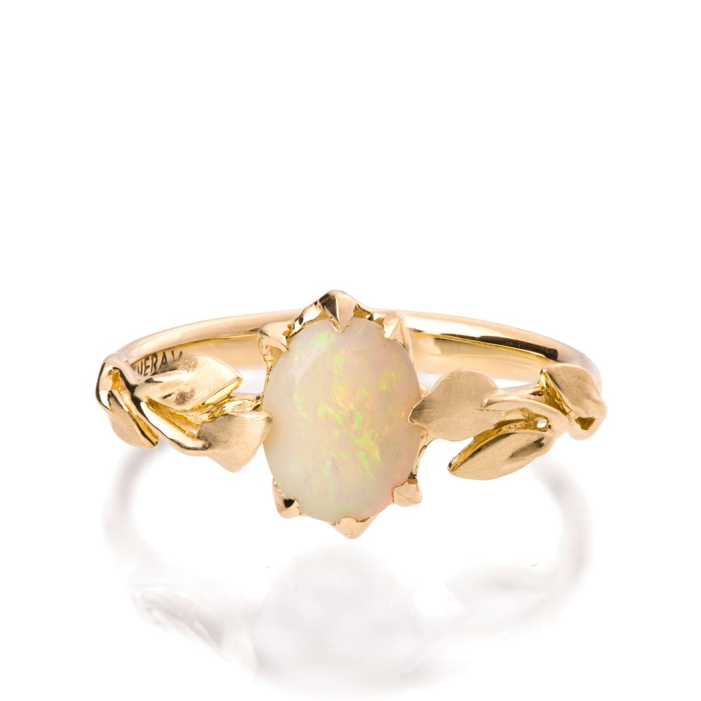 Beautifully quaint is how we would describe an opal engagement ring ($950) with a leaf band.