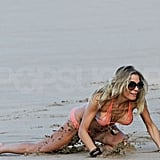 LeAnn dove to catch a football in the sand.