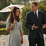 Kate Middleton had a parasol with her for her visit to the Kranji War Memorial alongside Prince William.