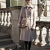 The classic trench looks great with a statement bag and boots.