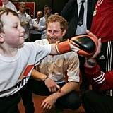 Prince Harry was all smiles as he watched a young boy show off his boxing skills during a visit to the Double Jab Boxing Club in London in June.