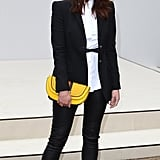 Gemma Arterton made an appearance at the Burberry show in black, white, and a pop of yellow.