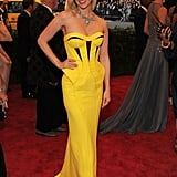 January Jones showed off her hot yellow Versace.