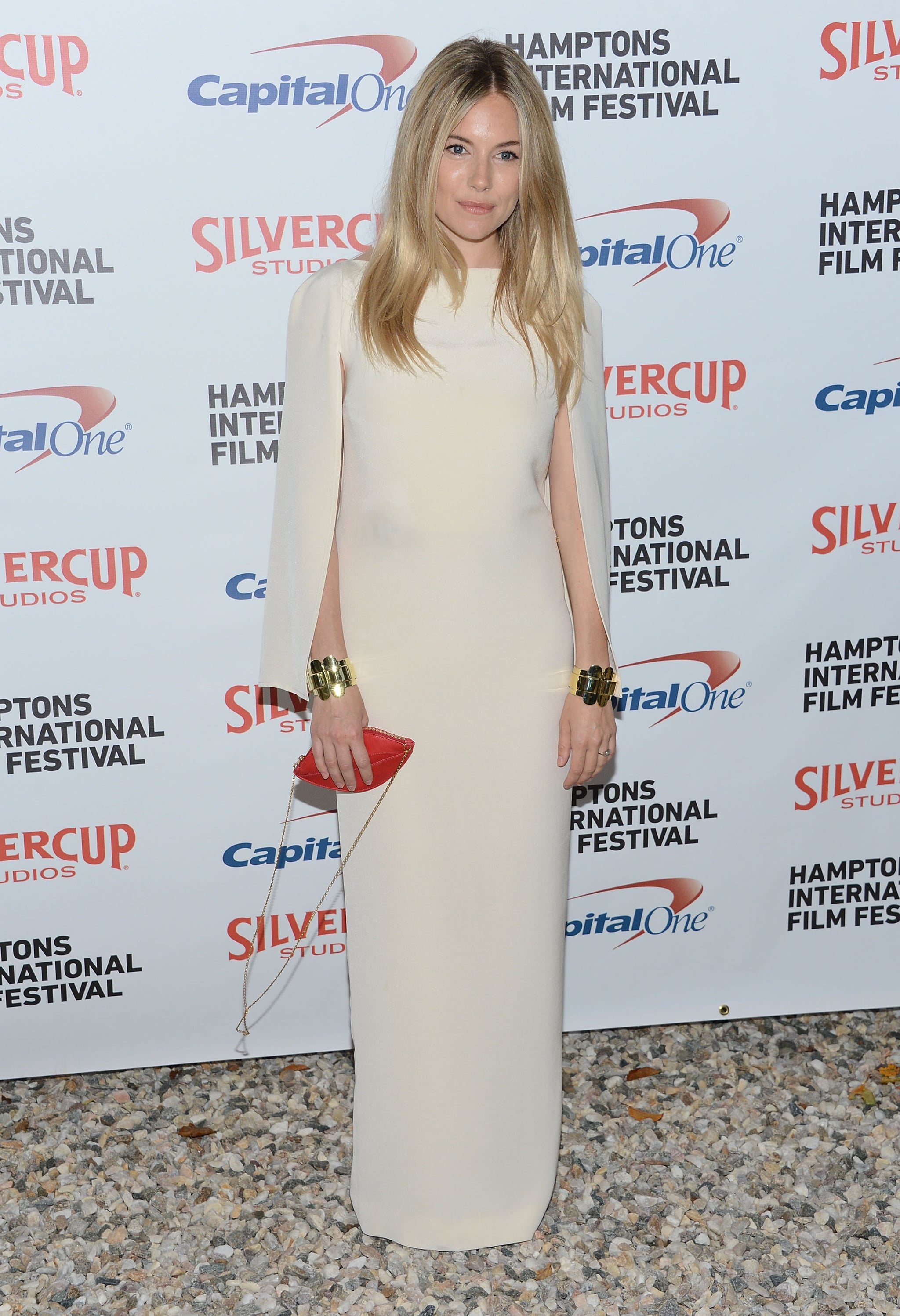 A sleek and glamorous Sienna wore a white Alessandra Rich dress to the 20th Hamptons International Film Festival in October 2012.