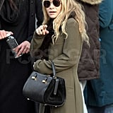 Ashley Olsen stayed warm with a chic fur collar.