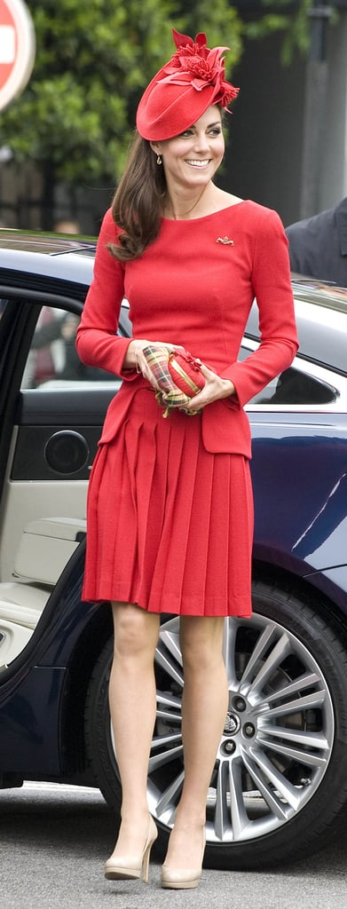 Kate lit up on arrival, showing off her fit-and-flare pleated frock.