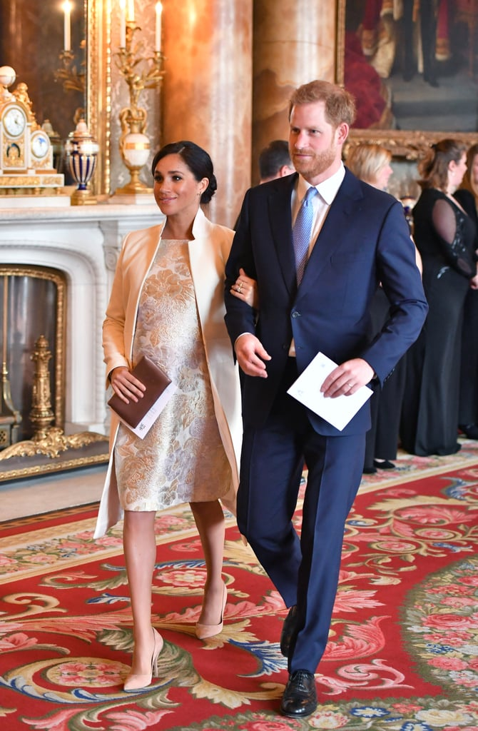 Meghan Markle has added another incredible maternity dress to her growing collection. She and Prince Harry joined the Duke and Duchess of Cambridge and a number of other royals for a special celebration in honor of Prince Charles on Tuesday, and of course Meghan's outfit did not disappoint. Even though the duchess wore an array of beautiful outfits during her mini tour of Morocco with Prince Harry, it appears she's not out of chic dresses yet. At the reception, which was hosted by Queen Elizabeth II, Meghan looked incredibly regal and radiant in a silver and gold brocade dress under an Amanda Wakeley coat, accessorized with a Wilbur and Gussie clutch, Maison Birks earrings, and suede heels by Paul Andrew. Ahead, get a closer look at the outfit from all angles, then see what her sister-in-law Kate Middleton wore.      Related:                                                                                                           Meghan Markle Had the Best Maternity Style, Now Let Her Looks Inspire You