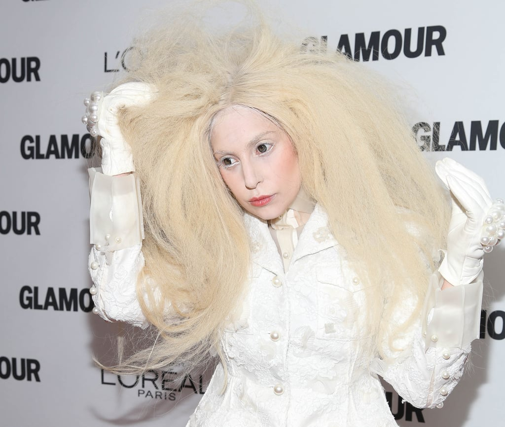 We've come to expect the unexpected from Lady Gaga, and she didn't disappoint on last night's red carpet. Her wig of choice was a platinum-blond Afro, while her makeup was muted with white powder and white eyeliner. She went for a flush of rosy color on her lips and cheeks.