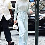 What Matches: Gigi's Stalvey bag and white patent Stuart Weitzman boots. Gigi worked a foundation of cool Sally LaPointe separates with the accessories.