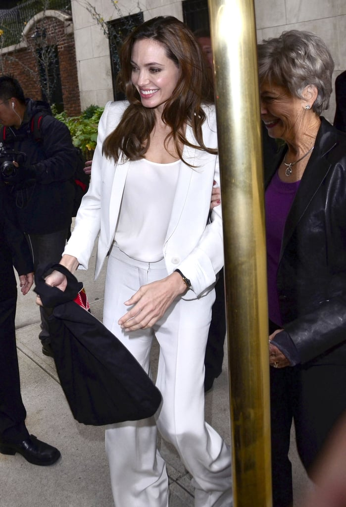 Angelina Jolie carried a black bag.