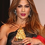 Jennifer Lopez showed off her award at the UNESCO Charity Gala in Germany.