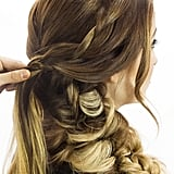 Now you can finally let down the two side sections! Use each piece to create two separate, loosely woven french braids that start at the part, then join together to create one plait at the center back. For more guidance on french braids, go here.