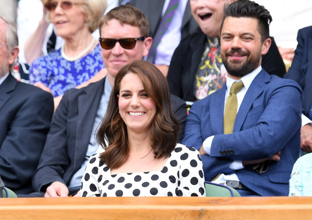 "The Duchess of Cambridge couldn't look more excited as she attended the opening day of Wimbledon in London on Monday. After meeting with boys and girls from the All England Lawn Tennis Club, Kate settled down in the royal box to watch the matches. Sporting a new haircut and a polka dot dress, the Duchess flashed a huge grin as she cheered on the tennis players at the event, including Britain's own Andy Murray. Aside from mingling with AELTC chairman Philip Brook in between shots, she also scored a seat in front of English actor Dominic Cooper.  It's no secret that Kate has always been an avid fan of tennis. In addition to playing the sport while attending St Andrews, Kate revealed during a BBC documentary that when she was eight months pregnant with George, she begged her doctor to let her go to Wimbledon but he ""banned"" her from attending, causing her to miss Andy Murray's victory against Novak Djokovic. ""I was very heavily pregnant,"" she told presenter Sue Barker. ""I wrote to him [Andy] afterwards saying sorry for not being there."""