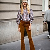 Romee Strijd Was Seen Wearing a Flat Cap With a Plaid Top and Brown Trousers During PFW