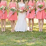All six of these bridesmaids wore matching knee-length coral dresses.